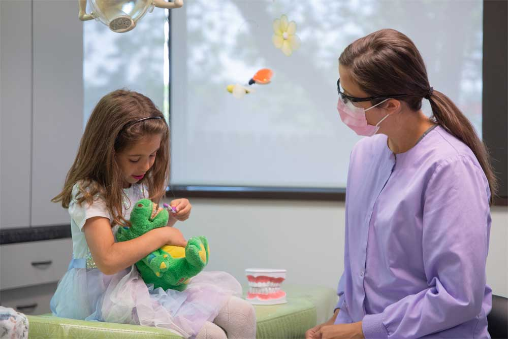 Dr. Robelli with a patient - - Pediatric Dental Specialist Jocelyn M. Robelli Roseville, MI
