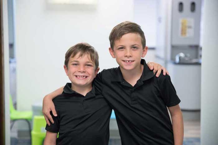 Boy in black polo style shirts - - Pediatric Dental Specialist Jocelyn M. Robelli Roseville, MI